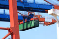 Crane lifting cargo container Royalty Free Stock Image