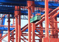 Crane lifting cargo container Stock Images