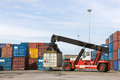 Crane lifting up container in the cargo at the port. Royalty Free Stock Photo