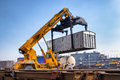 Crane lifts a container loading a train lifting up in railroad yard Stock Images