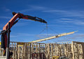 Crane lifts trusses onto new houses under construction on housing estate Royalty Free Stock Photos