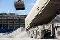Crane loading cargo ship with gravel Royalty Free Stock Image