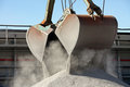 Crane loading gravel Royalty Free Stock Photo