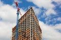 Crane near a skyscraper under construction Royalty Free Stock Photo