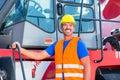 Crane operator standing on company yard Royalty Free Stock Photo