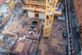 Crane rising through floor of highrise under construction Royalty Free Stock Photo