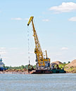 Crane river with barge loading sand the help of a on a white russia Royalty Free Stock Photos
