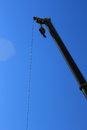 Crane a at work,a mechanical device Royalty Free Stock Photo