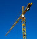 Crane at work taken on a sunny day Royalty Free Stock Photo