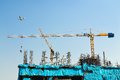 Crane working big construction site Royalty Free Stock Image