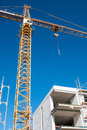 Crane in Yellow above a construction site Royalty Free Stock Photo