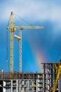 Cranes building industrial sky rain rainbow. Royalty Free Stock Photo