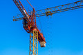 Cranes on a construction site at the cloudless blue sky Royalty Free Stock Photos