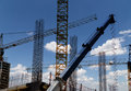 Cranes on a construction site industrial image Royalty Free Stock Photography