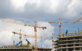 Cranes on a construction site industrial image Stock Images