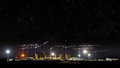 Cranes at construction site, night panorama starry sky Royalty Free Stock Photo