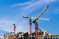 Cranes at construction site in singapore Royalty Free Stock Image
