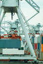 Cranes with containers in a harbor Stock Photo