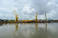 Cranes on docks industrial zone romanian side of the danube Royalty Free Stock Photos