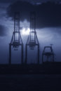 Cranes in harbor at night Royalty Free Stock Photo