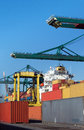 Cranes loading containers heavy into ships in antwerp world port Stock Photography