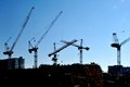 Cranes on the skyline construction builiding highrises in toronto Royalty Free Stock Image