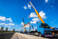 Cranes truck lifting bridge section heavy duty a load of fifty ton new concrete off trailer into place or position on umgeni Stock Photography