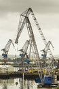 Cranes working at the port in ferrol spain Royalty Free Stock Image