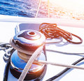Crank handle of sailboat detail yacht holder for rope bright sunset in the sea summer holidays luxury water transport yachting Stock Images