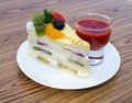Crape cake with mix fruit topping on the wood table thailand Royalty Free Stock Photo