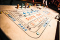 Craps table and people gambling all around chips piles Stock Photo