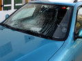 The crashed car heated rear window broken by an accidentally cast stone Stock Images