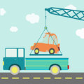 Crashed car on a truck crane carrying being put the road blue sky in the background Stock Photos