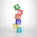 Crashing budget tower series words out of letter dices colored Stock Photography