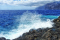 Crashing wave in tenerife canary islands a spraying as it hits the rocks one of the spain Royalty Free Stock Photo