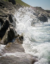 Crashing waves against the rocks on an ocean waterfront Stock Photo