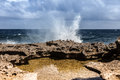 Crashing waves the north coast of curacao playa kanao or surf beach caribbean Stock Photo