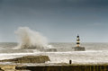 Crashing waves over seaham harbour the north pier in a rough sea at seahan Stock Images