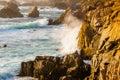Crashing waves turbulent ocean into rocky shoreline Royalty Free Stock Images