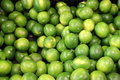 Crate of fresh,juicy limes at market Royalty Free Stock Photo