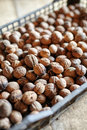 Crate of walnuts closeup a with on a wooden floor Stock Images