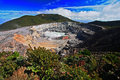 The crater and the lake of the Poas volcano in Costa Rica. Volcano landscape from Costa Rica. Active volcano with blue sky with cl Royalty Free Stock Photo