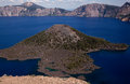 Crater lake and wizard island in the foreground the geography surrounded by the deep blues of showing the beautiful tourmaline Royalty Free Stock Photo