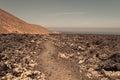 Crater rim trail through a lava field next to the caldera blanca lanzarote Stock Image
