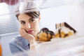 Craving sweet food young hungry woman in front of refrigerator chocolate pastries Stock Photography