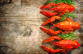 Crawfish. Red boiled crayfish on a wooden table Royalty Free Stock Photo