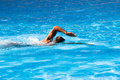 Crawl style swim young man in outdoor swimming pool sunny summer day Royalty Free Stock Photos