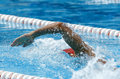 Crawl swimmer male swimming in a competition swim pool Stock Photos