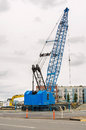 Crawler crane at a construction site on a cloudy day Stock Photos