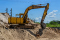 Crawler loader machinery dip up sand for construction Stock Image